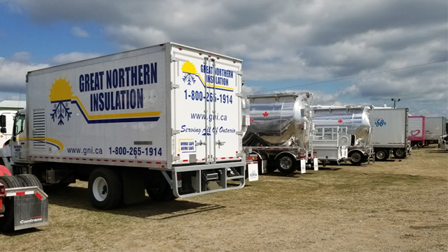 The participating Great Northern Insulation truck waits in line with other participating convoy trucks.